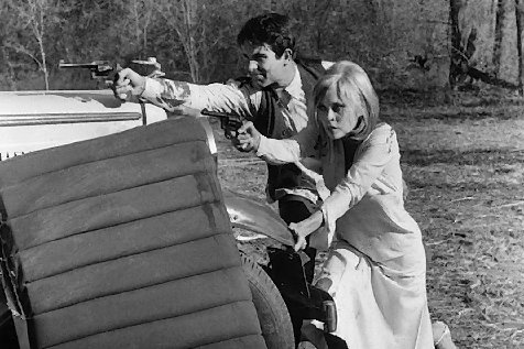 Stripped of moral scruples, Clyde (Warren Beatty) and Bonnie (Faye Dunaway) defend against the law in Arthur Penn's Bonnie and Clyde.